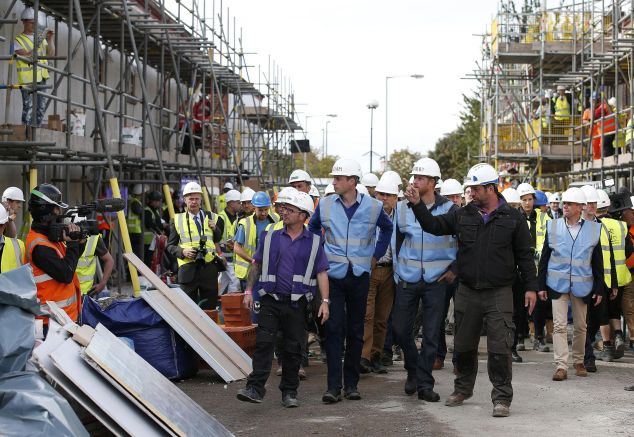The brothers touring the construction site. (Photo: PHIL NOBLE/AFP/Getty Images)