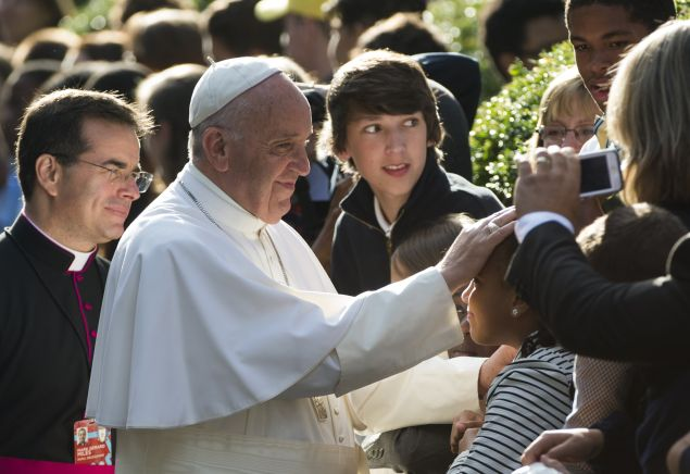 Pope Francis greets well-wishers the Apostolic Nunciature to the United States on September 24, 2015 in Washington, DC. AFP PHOTO/MOLLY RILEY (Photo credit should read MOLLY RILEY/AFP/Getty Images)