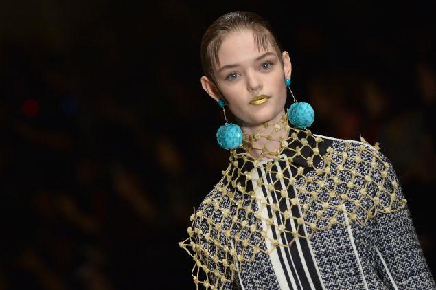 Gold lips, big earrings (Photo: Tiziana Fabi/AFP/Getty Images)
