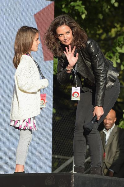 Katie Holmes in her leather jacket, with daughter Suri Cruise (Photo: Theo Wargo/Getty Images for Global Citizen).