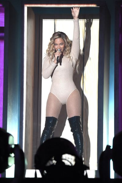 Beyoncé paired her nude bodysuit with a pair of patent leather boots (Photo: Theo Wargo/Getty Images for Global Citizen).