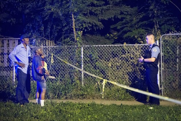 CHICAGO, IL - SEPTEMBER 28: Police officers secure a shooting scene where 5 people were reported to have been shot, including an 11-month-old infant, on September 28, 2015 in Chicago, Illinois. Chicago, like many major cities in the United States, has experienced a surge in shootings this year. (Photo by Scott Olson/Getty Images)