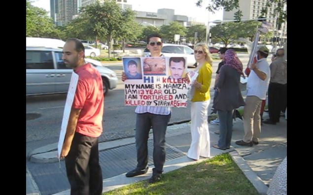 This photo of protestors demanding action against Assad was taken in Houston on May 29, 2011—more than four years ago. Since then, more than 11 million Syrians have been displaced and more than 220,000 killed. The boy pictured on the sign is Hamza Ali Al-Khateeb,  (New York Observer)