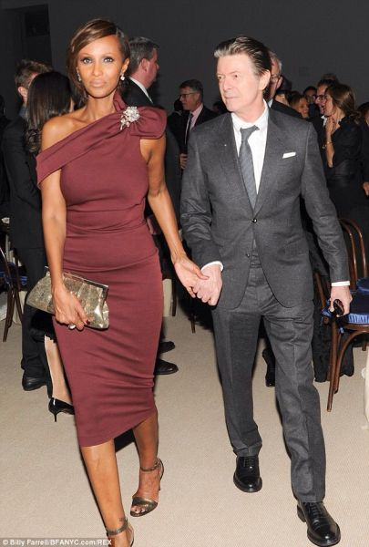 David Bowie (not quite as young but still beautiful), shown here with his wife Iman at the Museum of Modern Art 2013. (Courtesy: BFANYC)