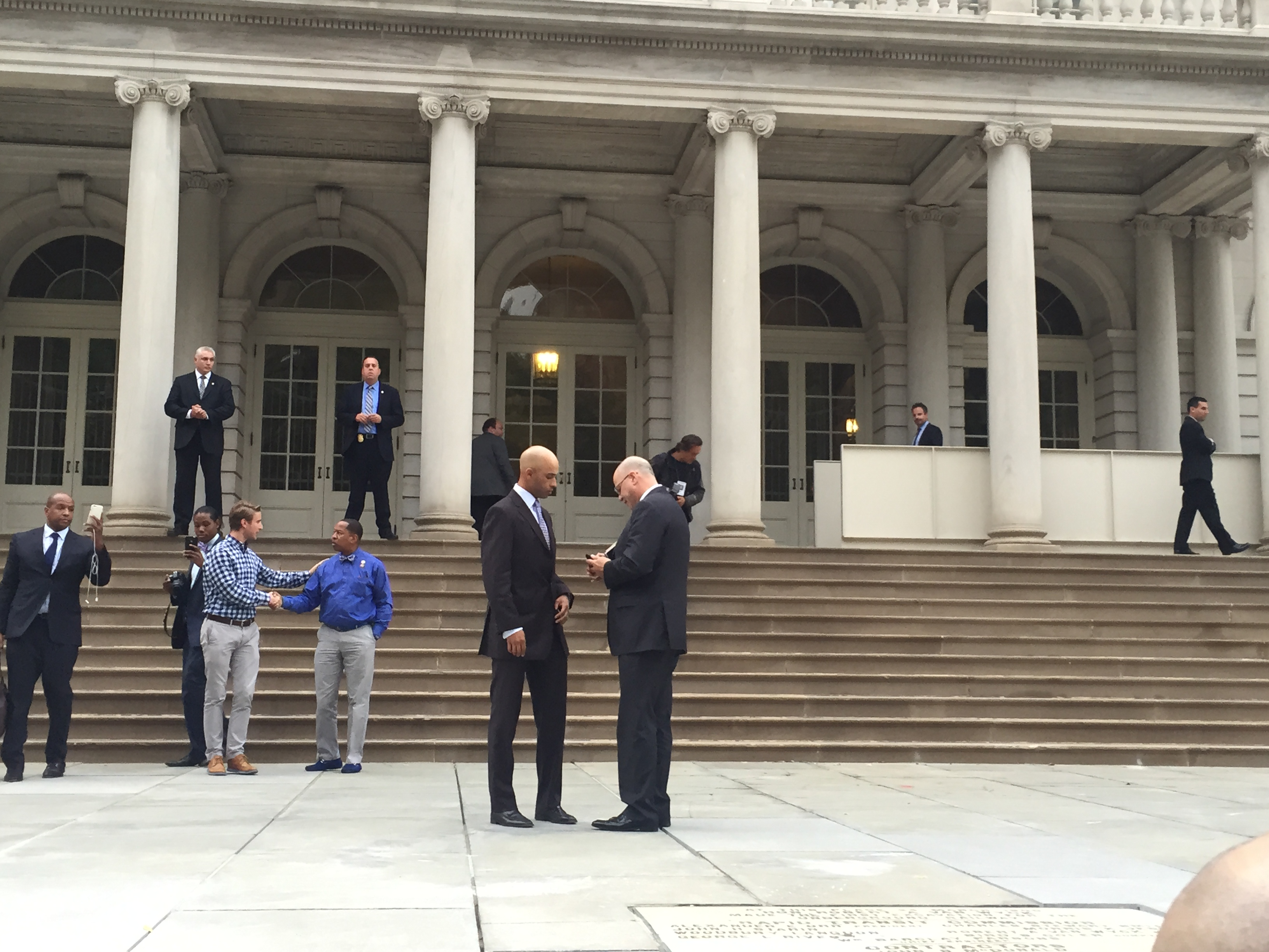 Tennis player James Blake talks with his lawyer Kevin Marino outside City Hall. (Photo: Jillian Jorgensen for Observer)