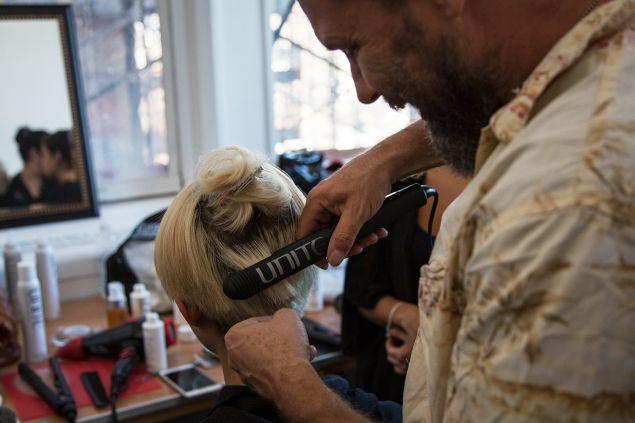 Mr. Ryan straightening a model's hair. (Photo: Observer/Kaitlyn Flannagan)