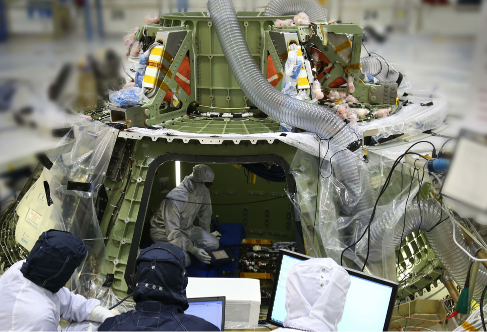 Technicians work inside the Orion crew module being built at Kennedy Space Center (Lockheed Martin)
