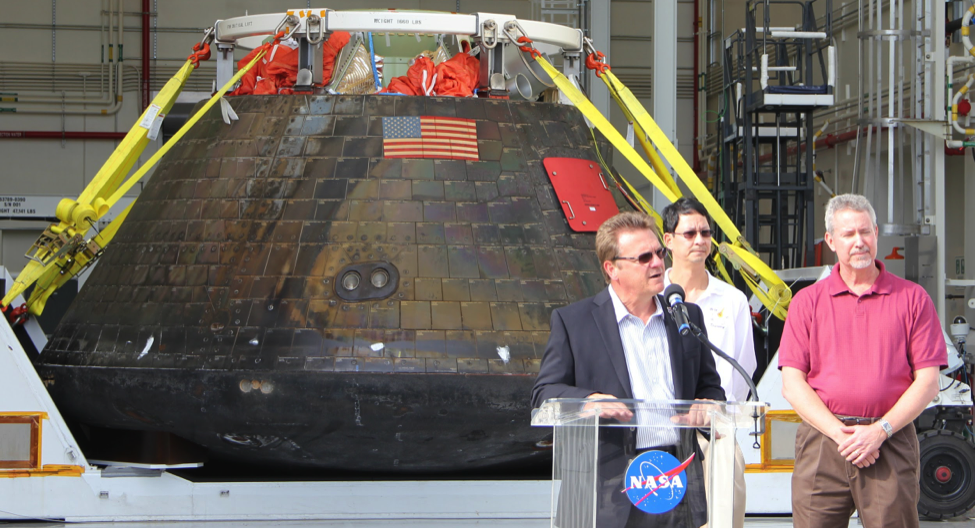 Orion Operations Manager Jules Schneider and NASA Ground Systems Manager Philip Weber speak to the press following the return of Orion to Kennedy after Exploration Flight Test 1 (Robin Seemangal)