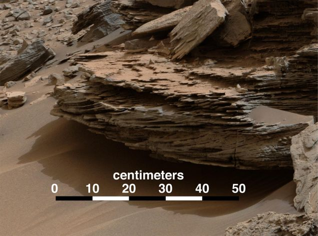 "Relevant to the discovery, this image shows evidence of cross-bedding, which results from water passing over a loose bed of sediment. Taken Nov. 2, 2014 at ""Whale Rock"" within the ""Pahrump Hills,"" the rover was at Mount Sharp. (Photo: NASA/Public Domain)"