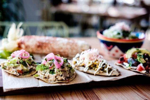 Tostadas de salpicon de atun, tlacoyo and tlayuda Oaxaquena at Rosie's. (Photo: Chris Sorensen/For New York Observer)