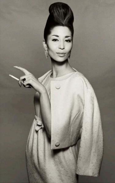 China Machado. Suit by Ben Zuckerman, New York, November 6, 1958. Photographed by Richard Avedon.
