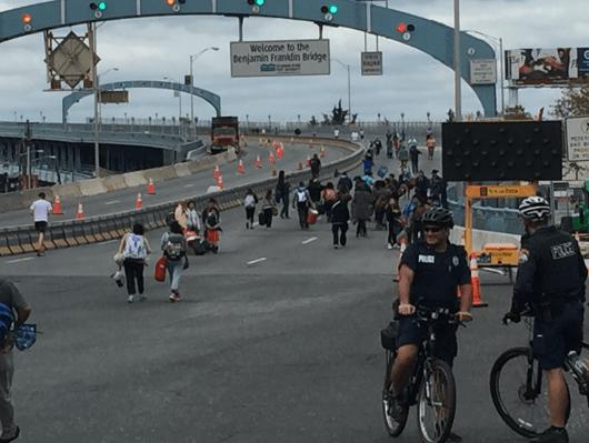 Pilgrims crowd the EZ Pass lane at the entrance to the Benjamin Franklin Bridge in Camden