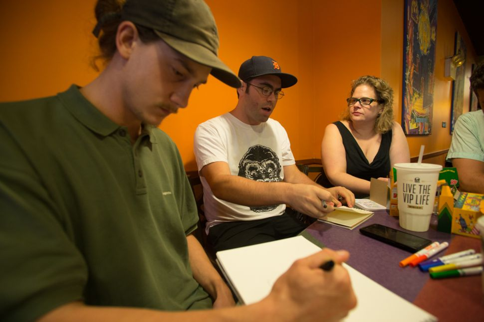 Jason Polan (middle) has been throwing the Taco Bell eat and draw for 10 years. - Aaron Adler for New York Observer