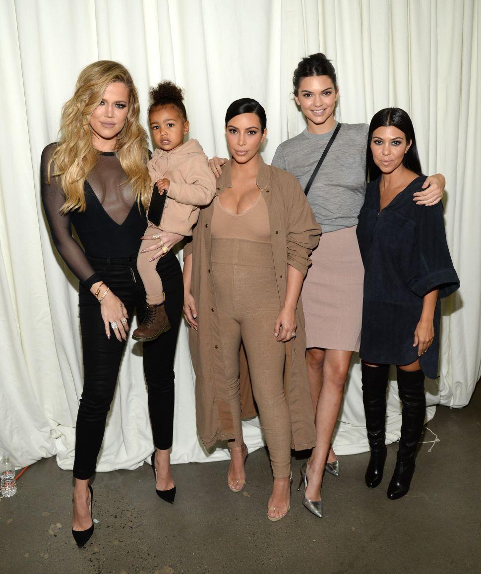 Khloe Kardashian, North West, Kim Kardashian West, Kendall Jenner and Kourtney Kardashian (Photo by Kevin Mazur/Getty Images for Kanye West Yeezy)