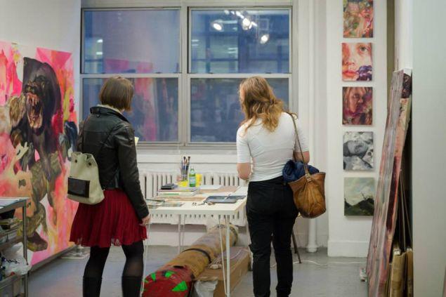 Visitors in Angela Fraleigh's studio during EFA Open Studios 2014. (Photo: Matthew Vicar)