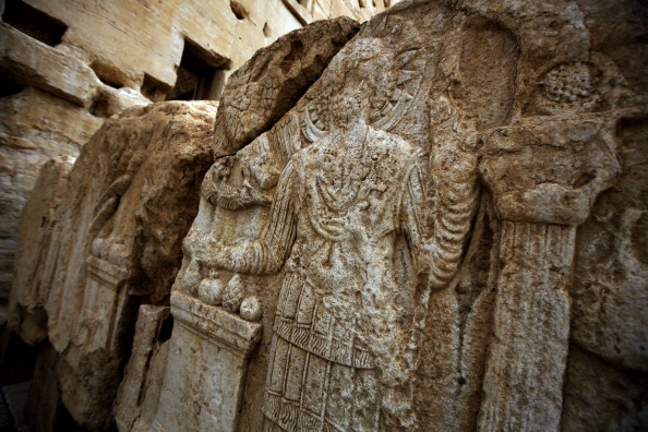 A picture taken on March 14, 2014 shows carvings on a wall in the courtyard of the sanctury of Baal in the ancient oasis city of Palmyra, 215 kilometres northeast of Damascus. From the 1st to the 2nd century, the art and architecture of Palmyra, standing at the crossroads of several civilizations, married Graeco-Roman techniques with local traditions and Persian influences. AFP PHOTO/JOSEPH EID (Photo credit should read JOSEPH EID/AFP/Getty Images)