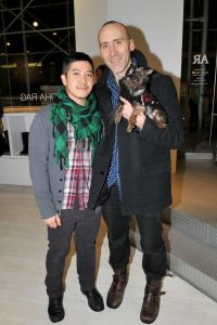 Thakoon Panichgul with his partner, Russ Spina, and their Yorkie/Chihuahua mix, Stevie - the new residents of a $2.7 million TriBeCa loft. (JONATHON ZIEGLER/Patrick McMullan)