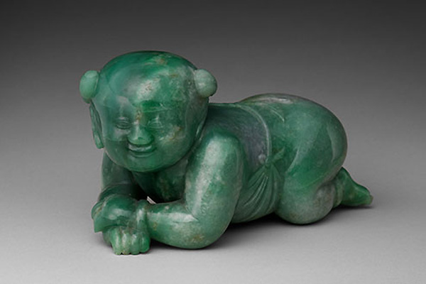 Pillow in the Form of an Infant Boy, Qing dynasty (1644–1911). Gift of Heber R. Bishop, 1902. (Photo: Courtesy The Metropolitan Museum of Art)