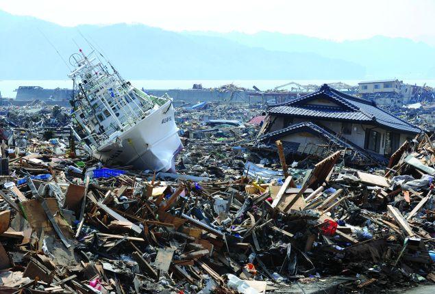 A fishing boat lies among the tsunami rubble at Otsuchi town in Iwate. (Photo: TOSHIFUMI KITAMURA/AFP/Getty Images)