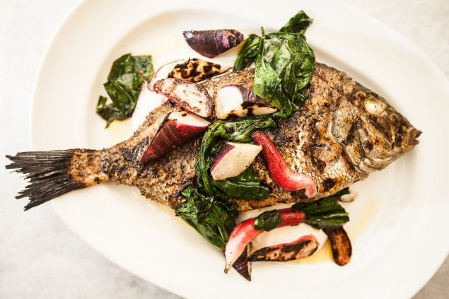 Whole porgy stuffed with lemon. (Photo: Emily Assiran for Observer)