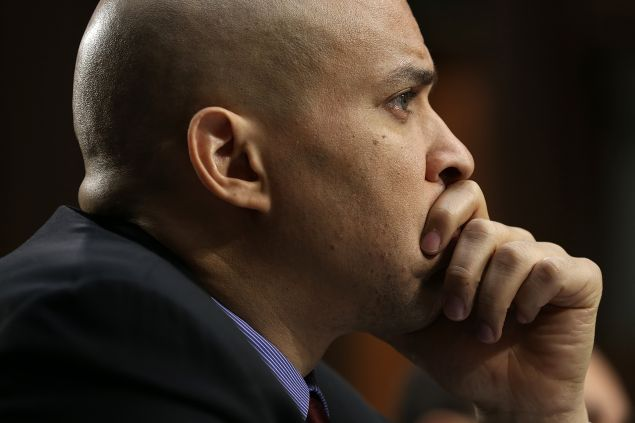 "WASHINGTON, DC - DECEMBER 09: Sen. Cory Booker (D-NJ) testifies before the Senate Judiciary Committee's Constitution, Civil Rights and Human Rights Subcommittee December 9, 2014 in Washington, DC. The subcommittee heard testimony on the topic of ""The State of Civil and Human Rights in the United States."" (Photo by Win McNamee/Getty Images)"