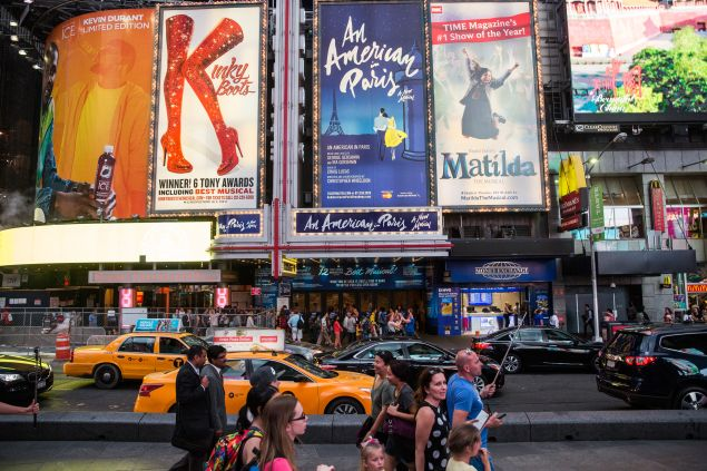 NEW YORK, NY - MAY 27: Broadway play advertisements are seen in Times Square on May 27, 2015 in New York City. Broadway theaters drew more than 13 million attendees - a new record - and sold $1.365 billion worth of tickets in the theater year, which ended Sunday. (Photo by Andrew Burton/Getty Images)