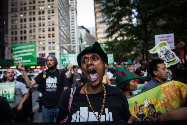Housing activists march from Zuccotti Park to New York City's City Hall to demand more affordable housing options for the homeless and poor. (Photo: Andrew Burton for Getty Images)