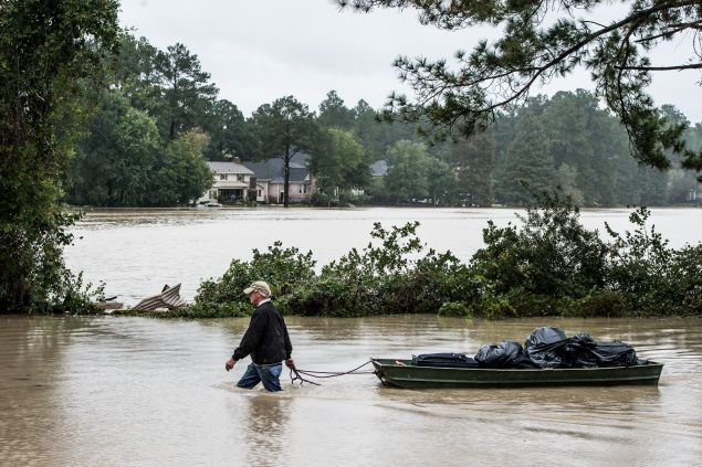 COLUMBIA, SC - OCTOBER 5: Eric Van Sant rescues possessions from a flooded home in the Forest Acres neighborhood October 5, 2015 in Columbia, South Carolina. The state of South Carolina experienced record rainfall amounts over the weekend which stranded motorists and residents and forced hundreds of evacuations and rescues. (Photo by Sean Rayford/Getty Images)