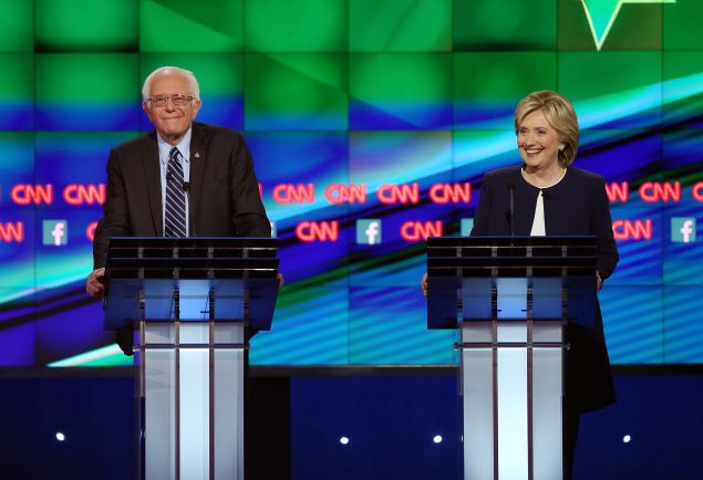 Democratic presidential candidates Sen. Bernie Sanders and Hillary Clinton take part in a presidential debate. (Photo by Joe Raedle/Getty Images)