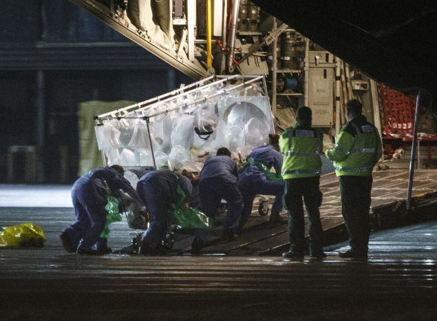 """(FILES) A file photo taken on December 30, 2014, shows medical personnel wheel a quarantine tent trolley containing Scottish healthcare worker Pauline Cafferkey, who was diagnosed with Ebola after returning to Scotland from Sierra Leone, into a Hercules Transport plane at Glasgow International Airport, bound for The Royal Free hospital in London. British nurse Pauline Cafferkey who was successfully treated in January 2015 after contracting Ebola in Sierra Leone is now """"critically ill"""" due to a resurgence of the virus, the hospital treating her said on October 14, 2015. """"We are sad to announce that Pauline Cafferkey's condition has deteriorated and she is now critically ill. Pauline is being treated for Ebola in the high-level isolation unit at the Royal Free Hospital,"""" it said in a statement. AFP PHOTO / STR (Photo credit should read -/AFP/Getty Images)"""