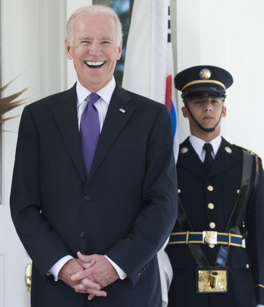 US Vice President Joe Biden laughs during the arrival of the South Korean President for lunch at the Naval Observatory in Washington, DC, October 15, 2015. AFP PHOTO / SAUL LOEB (Photo credit should read SAUL LOEB/AFP/Getty Images)