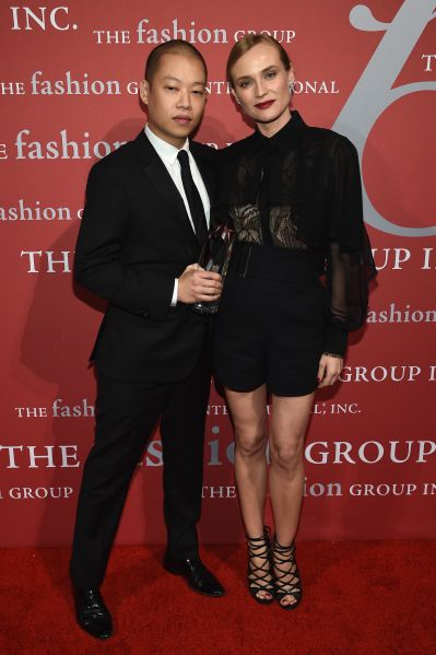 Jason Wu poses with his presenter, Diane Kruger (Photo: Dimitrios Kambouris/Getty Images).