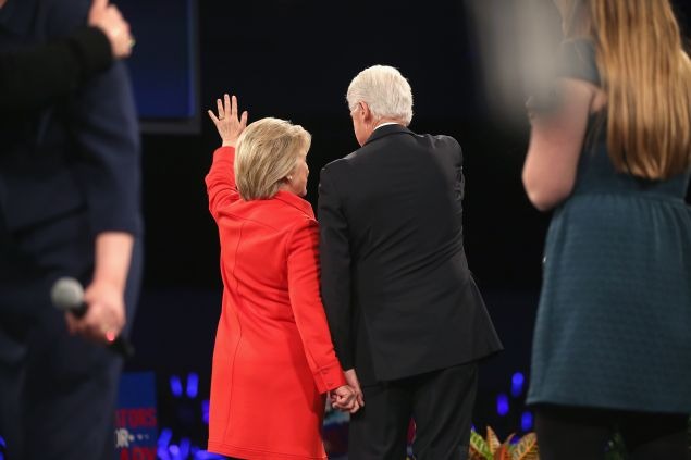 DES MOINES, IA - OCTOBER 24: Democratic presidential candidate Hillary Clinton and her husband former president Bill Clinton hold hands as they wave to guests at the end of the Jefferson-Jackson Dinner on October 24, 2015 in Des Moines, Iowa. The dinner is a major fundraiser for Iowa's Democratic Party. (Photo by Scott Olson/Getty Images)
