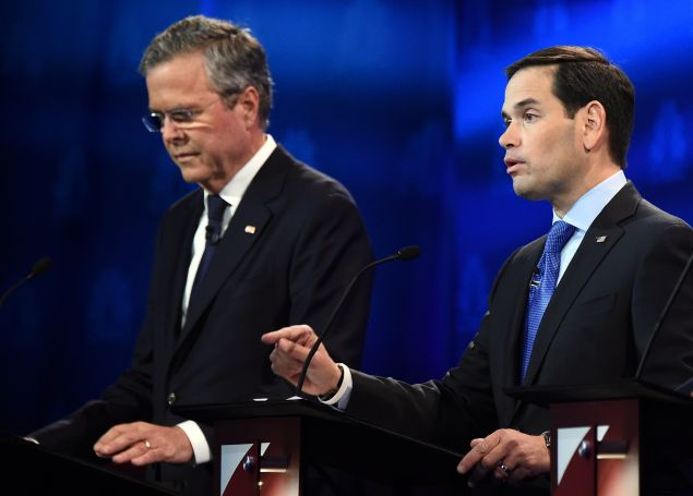 Republican Presidential hopeful Marco Rubio (R) speaks as Jeb Bush looks on during the CNBC Republican Presidential Debate, October 28, 2015 at the Coors Event Center at the University of Colorado in Boulder, Colorado. AFP PHOTO/ ROBYN BECK (Photo credit should read ROBYN BECK/AFP/Getty Images)