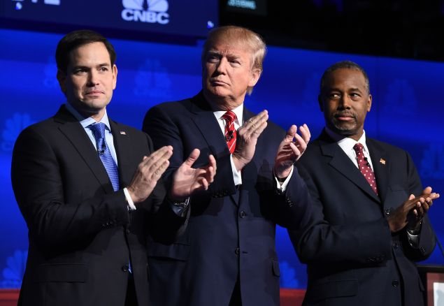 Republican presidential hopefuls (L-R) Marco Rubio, Donald Trump and Ben Carson applaud as the candidates are introduced at the start of the third Republican Presidential Debate, October 28, 2015 at the Coors Event Center at the University of Colorado in Boulder, Colorado. AFP PHOTO / ROBYN BECK (Photo credit should read ROBYN BECK/AFP/Getty Images)