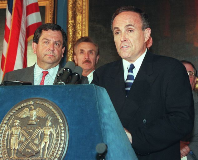 NEW YORK, UNITED STATES: New York City Mayor Rudy Giuliani (R) discusses 01 August the 31 July raid in Brooklyn which netted two terrorism suspects. James Kallstrom, the head of the FBI's New York office, stands next to Giuliani during the press conference at City Hall in New York. AFP PHOTO/ HENNY RAY ABRAMS (Photo credit should read HENNY RAY ABRAMS/AFP/Getty Images)