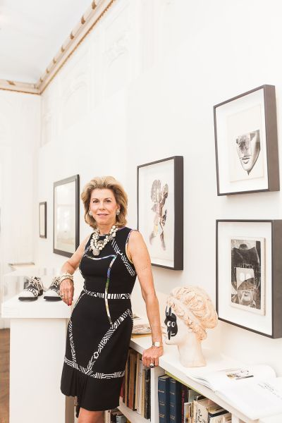 Frances Beatty in her office at the Feigen Gallery with Ray Johnson works around her. PHOTO: Emily Assiran for Observer