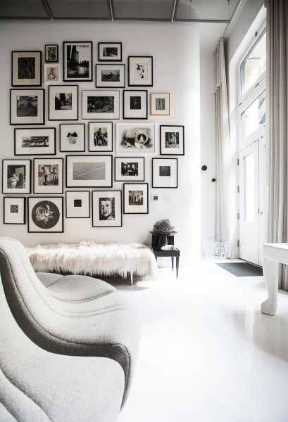 Living room with photograph wall. (Photo: Emily Assiran for Observer)