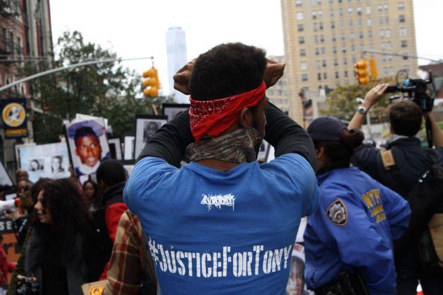 A protestor on 6th Avenue