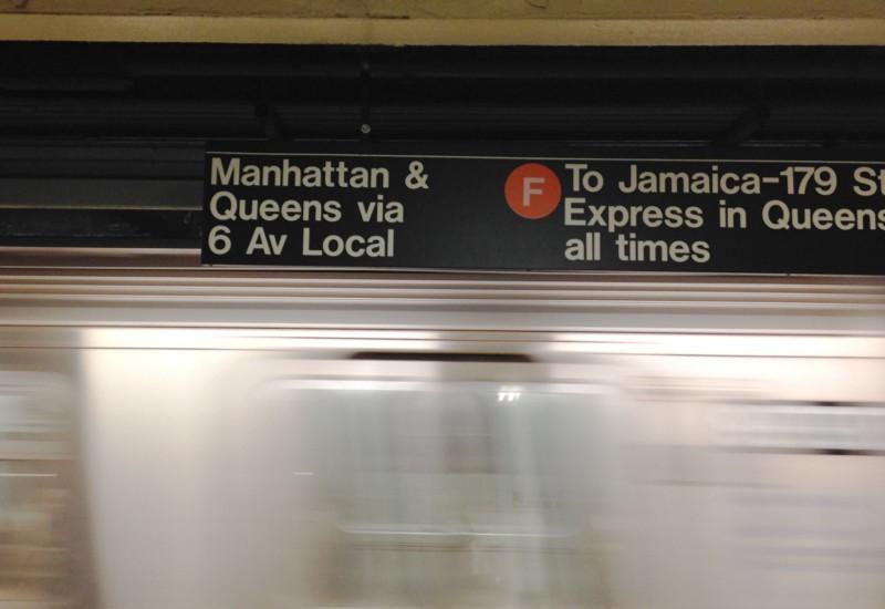 Sign above a subway platform.