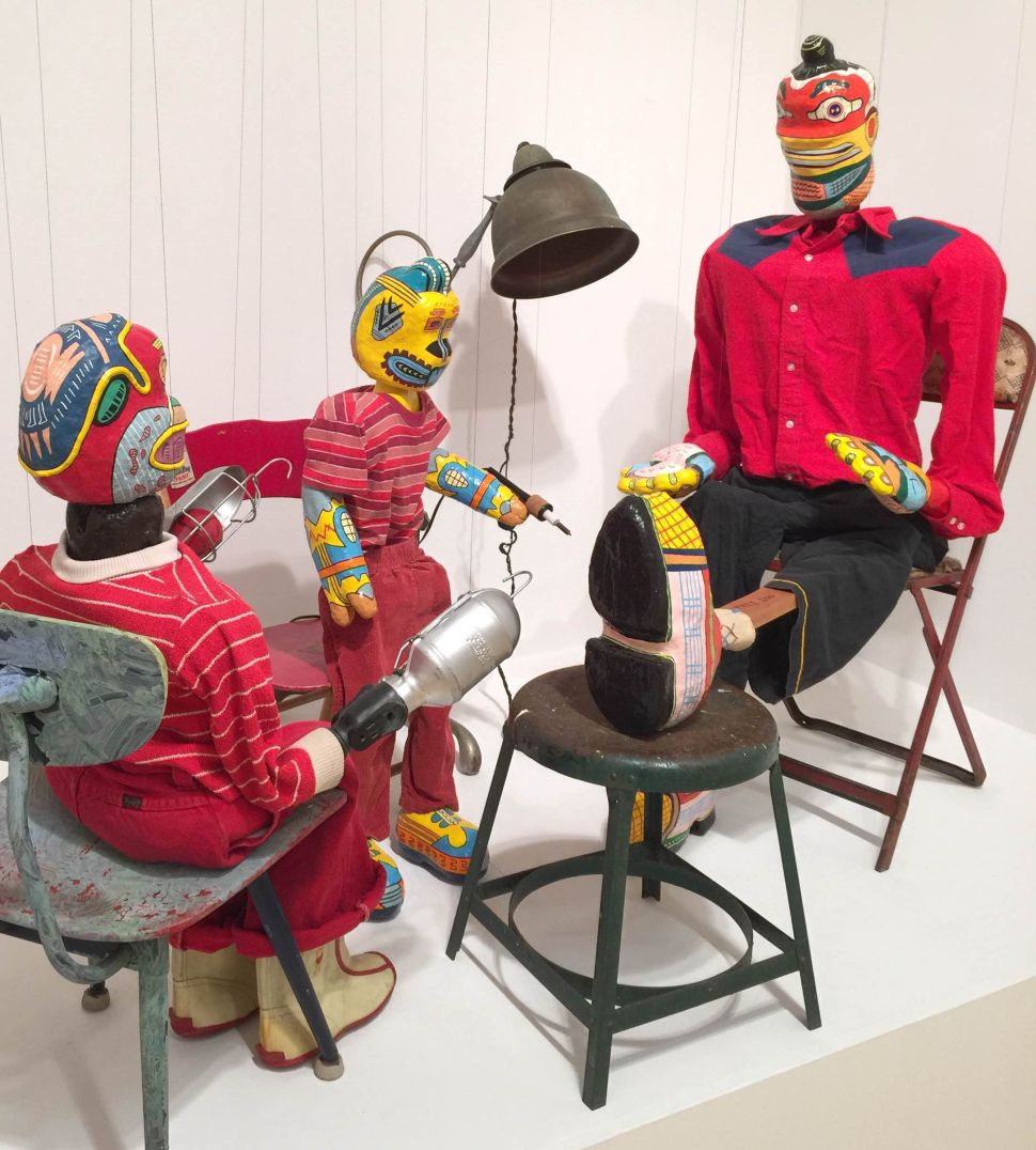 "Karl Wirsum, (left to right) ""Jimmy Jones Brother Jack, Jimmy Jones Junior, Tree Son"" (c. 1973-1974), acrylic, wood, fabric, leather, soldering pen, papier-mâché, and light fixtures, dimensions variable (Photo: Courtesy of Derek Eller Gallery, New York)"