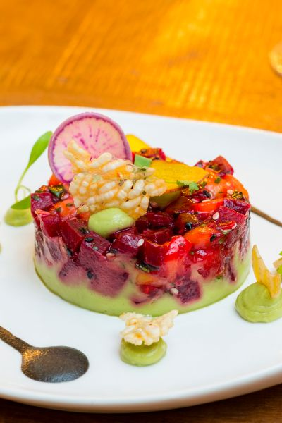 Beets with avocado, lime tamari dressing, mango and black sesame. (Photo: Melissa C. Goodwin for Observer)