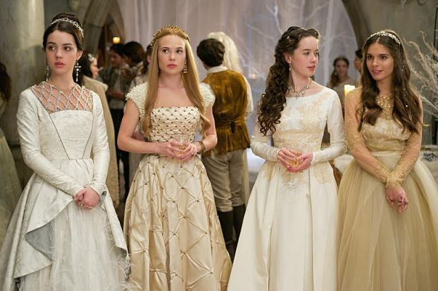 Adelaide Kane as Mary, Celina Sinden as Greer, Anna Popplewell as Lola and Caitlin Stasey as Kenna. On Mary: custom gown and Deborah Moreland headpiece, On Greer: vintage gown, Moyna pearl shrug. On Lola: Vintage bridal gown, Lulu Frost necklace. On Kenna: Marchesa Notte gown (Photo: Sven Frenzel/The CW).