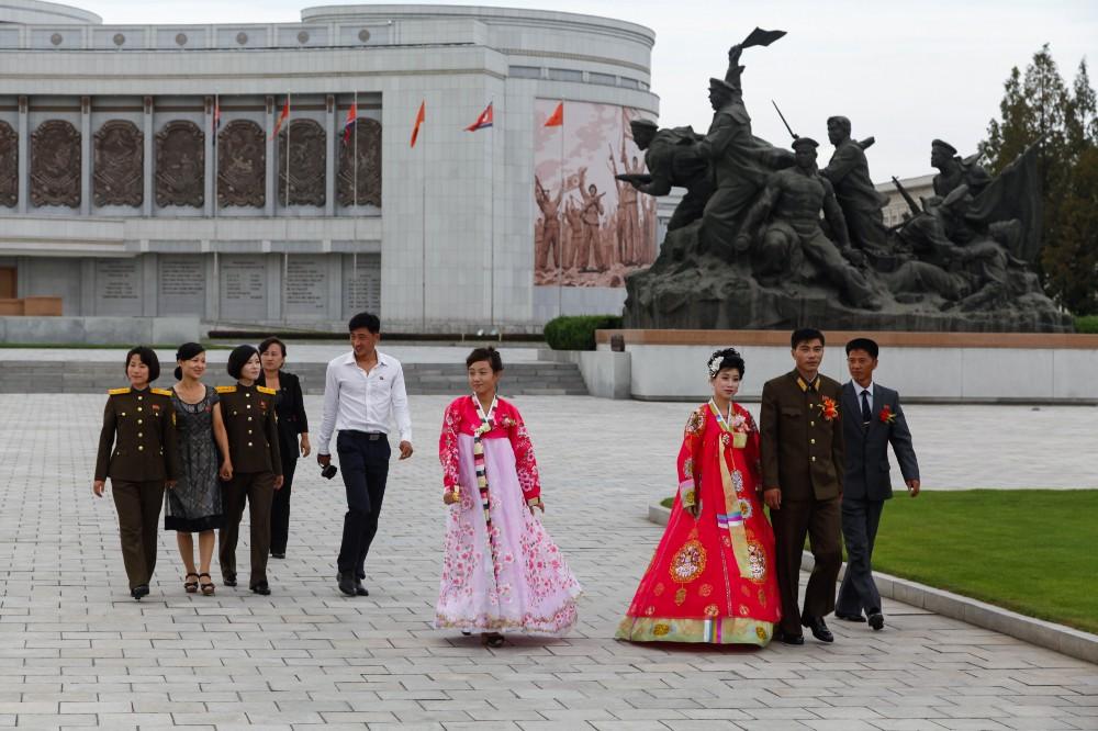 Newlyweds taking photographs at the Korean War Museum