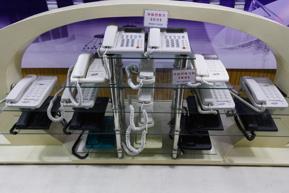 A display of landline phones at The Three Revolutions Museum