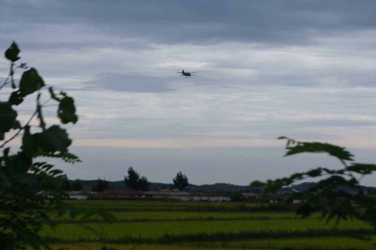 Military biplane flying overhead