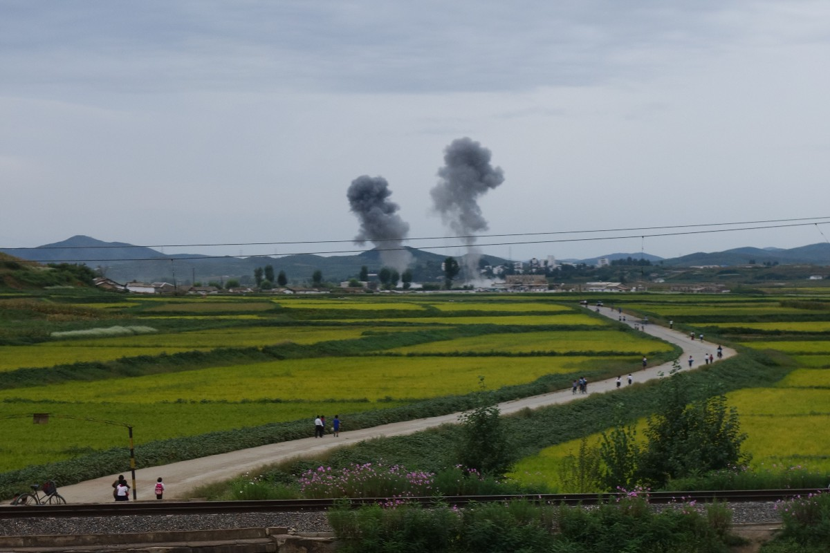 The aftermath of two rocket explosions, less than one mile away from us