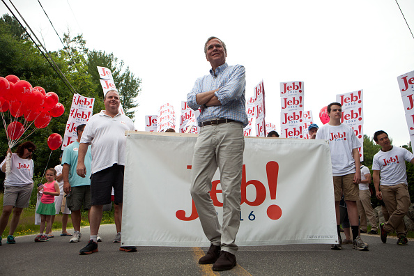 AMHERST, NH - JULY 4: Republican Presidential candidate Jeb Bush marches in the 4th of July Parade on July 4, 2015 in Amherst, New Hampshire. Bush is a front-runner in the polls for the 2016 presidential race with 14 other republican candidates. (Photo by Kayana Szymczak/Getty Images)