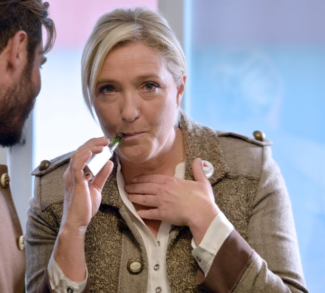 French far-right National Front (Front National, FN) party President Marine Le Pen (C), sokes an electronic cigaret prior to a press conference during a visit to the 28th International Livestock Trade Fair (SPACE, Salon international des Productions Animales) outside Rennes, northwestern France, on September 17, 2015. AFP PHOTO / JEAN FRANCOIS MONIER (Photo credit should read JEAN-FRANCOIS MONIER/AFP/Getty Images)