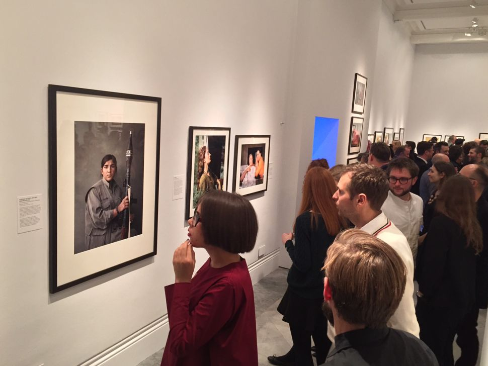 Visitors at the National Portrait Gallery look at Joey Lawrence's portrait of 'Sarya.' (Photo: Joey Lawrence)